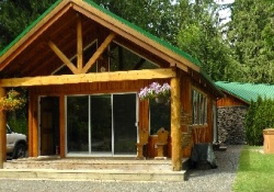 wooden cabin with sliding glass doors and patio,  pet friendly by owner vacation rentals in vancouver